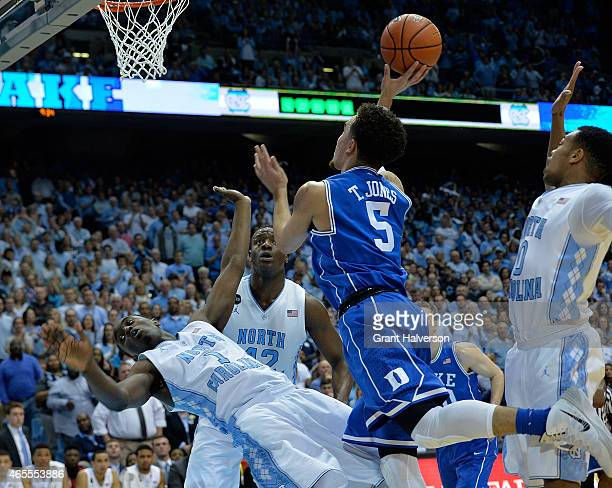 Tyus Jones of the Duke Blue Devils is called for a charge as he collides with Theo Pinson of the North Carolina Tar Heels during their game at the...