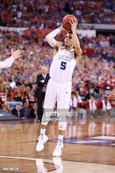 Tyus Jones of the Duke Blue Devils shoots late in the second half against the Wisconsin Badgers during the NCAA Men's Final Four National...