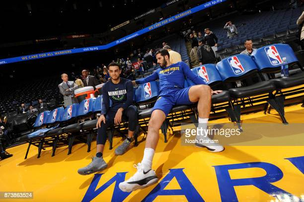 Tyus Jones of the Minnesota Timberwolves and Omri Casspi of the Golden State Warriors speak before game on November 8 2017 at ORACLE Arena in Oakland...