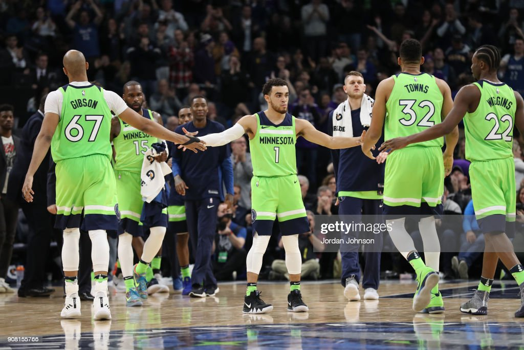 Tyus Jones #1 of the Minnesota Timberwolves high fives teammates during the game against the Toronto Raptors on January 20, 2018 at Target Center in Minneapolis, Minnesota.
