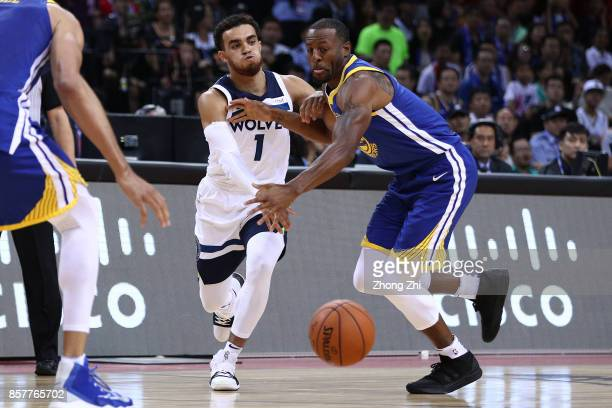 Tyus Jones of the Minnesota Timberwolves in action against Andre Iguodala of the Golden State Warriors during the game between the Minnesota...