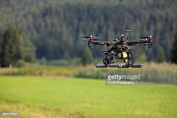Uav Drone flying in green grassland area