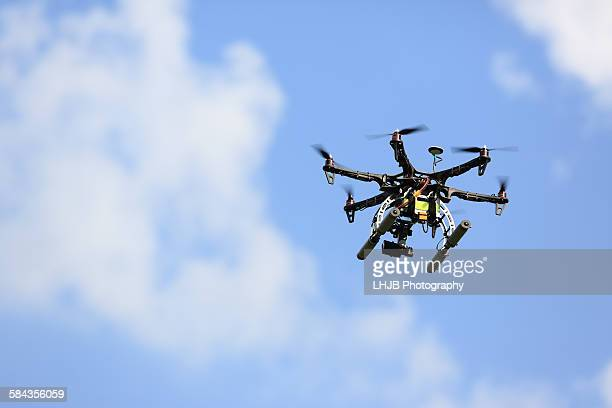Uav drone flying with camera at blue sky