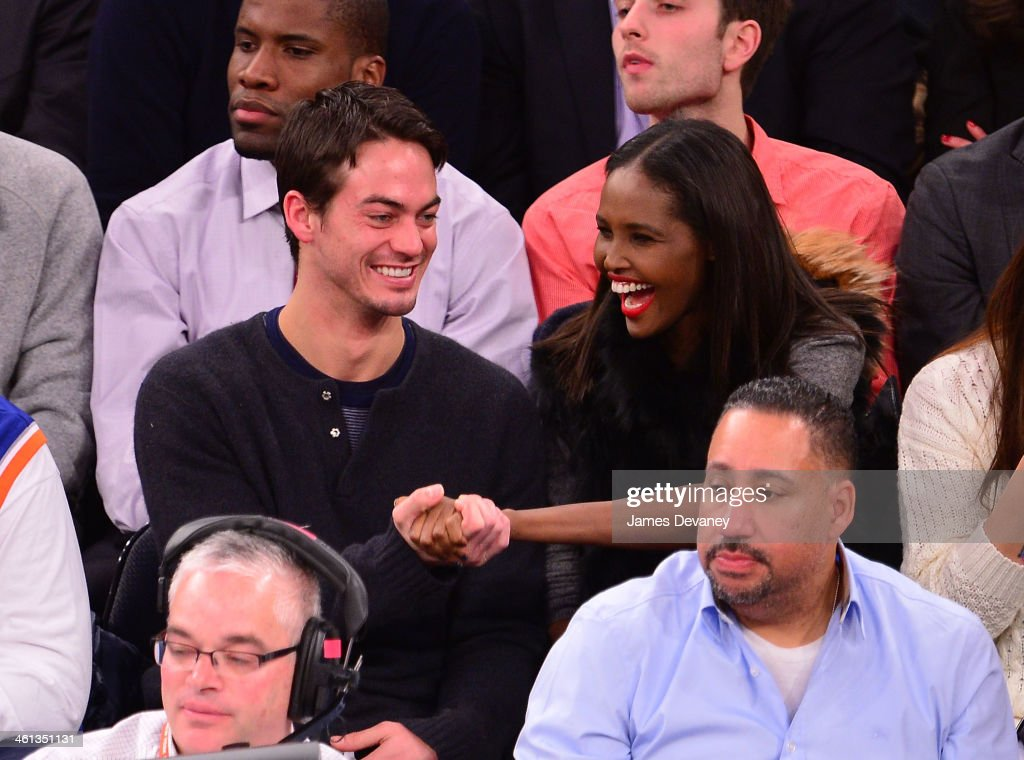 Ubah Hassan and guest (L) attend the Detroit Pistons vs New York Knicks game at Madison Square Garden on January 7, 2014 in New York City.