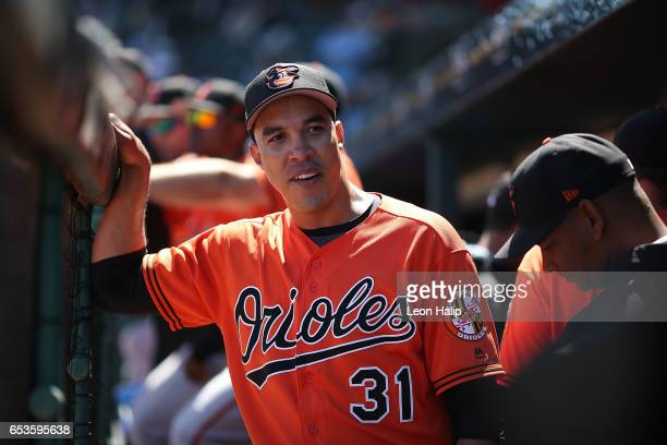 Ubaldo Jimenez of the Baltimore Orioles talks with his teammates in the dugout during the Spring Training Game against the Pittsburgh Pirates on...