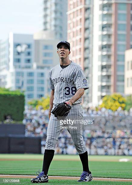 Ubaldo Jimenez of the Colorado Rockies walks off the field after pitching during the first inning of a baseball game against the San Diego Padres at...