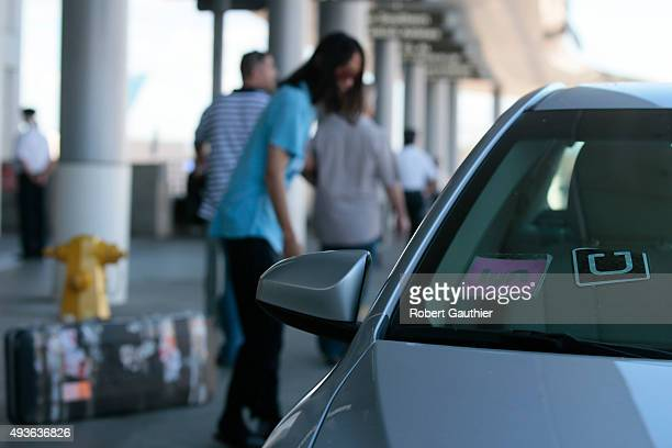 LOS ANGELES CA TUESDAY OCTOBER 20 2015 Uber and Lyft cars drop off passengers at the Bradley terminal at LAX