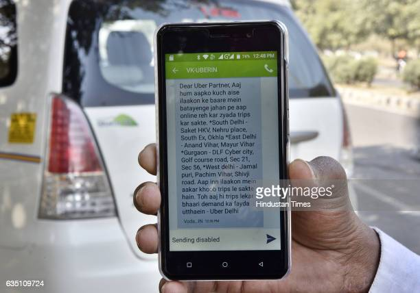 Uber cab driver shows today's Uber offer outside the Uber office at sector29 during the Uber and Ola Cab owners and drivers strike on February 13...