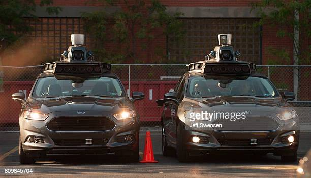 Uber driverless Ford Fusions sit in the Uber Technical Center parking lot on September 2016 in Pittsburgh Pennsylvania Uber has built its Uber...