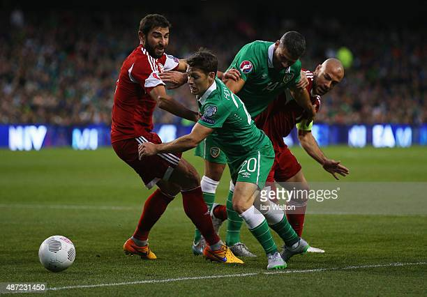 Ucha Lobjanidze of Georgia Wes Hoolahan of the Republic of Ireland Jonathan Walters of the Republic of Ireland and Jaba Kankava of Georgia battle for...