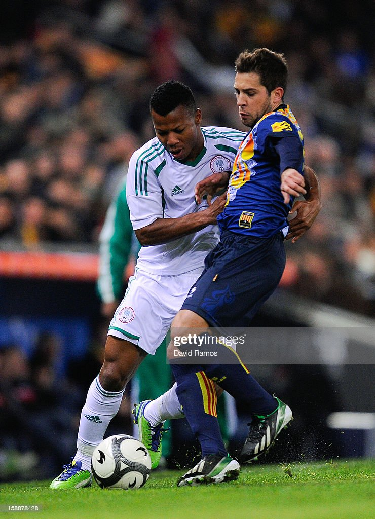 Uche Ikechukwu (L) of Nigeria duels for the ball with <a gi-track='captionPersonalityLinkClicked' href=/galleries/search?phrase=Jordi+Alba&family=editorial&specificpeople=5437949 ng-click='$event.stopPropagation()'>Jordi Alba</a> of Catalonia during a friendly match between Catalonia and Nigeria at Cornella-El Prat Stadium on January 2, 2013 in Barcelona, Spain.