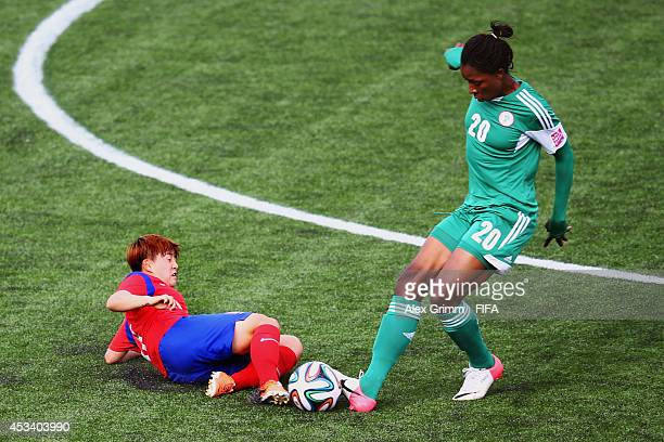 Uchechi Sunday Of Nigeria Is challenged by Lee Sodam Of Korea Republic during the FIFA U20 Women's World Cup Canada 2014 group C match between Korea...