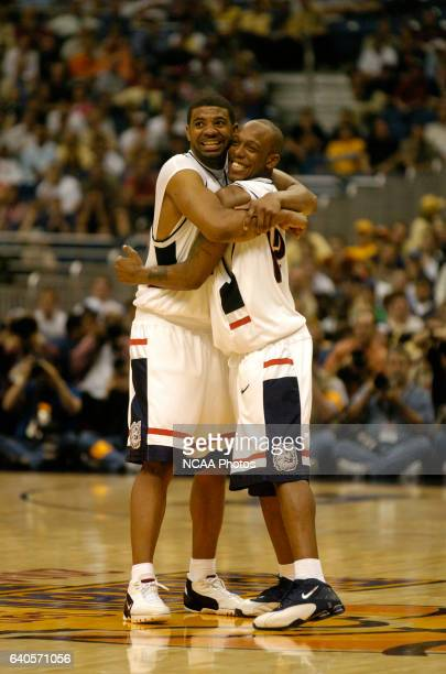 UConn forward Rashad Anderson hugs teammate guard Taliek Brown as the final seconds tick off the clock during the Division I Men's Basketball...