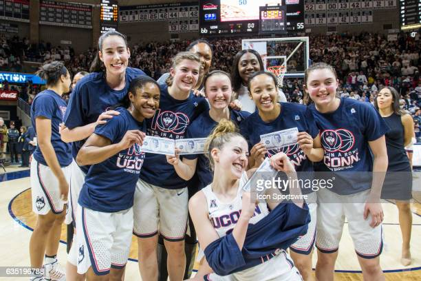 UConn Huskies celebrate after UConn Huskies Head Coach Geno Auriemma reaches the 100 consecutive win mark after defeating 6th ranked University of...