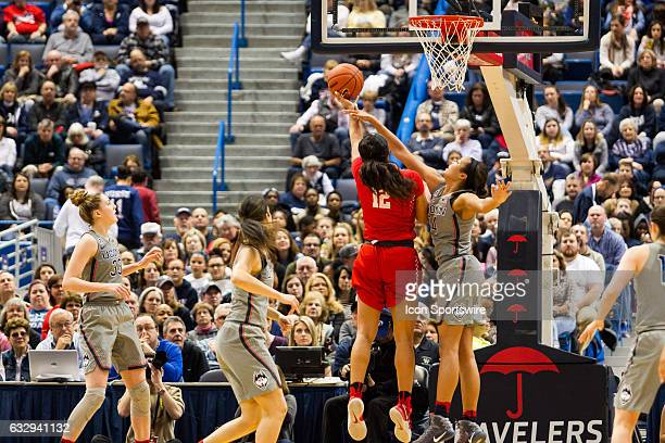 UConn Huskies Forward Napheesa Collier gets called for a foul blocking Houston Cougar's Forward Brianne Coffman during the first half a women's NCAA...
