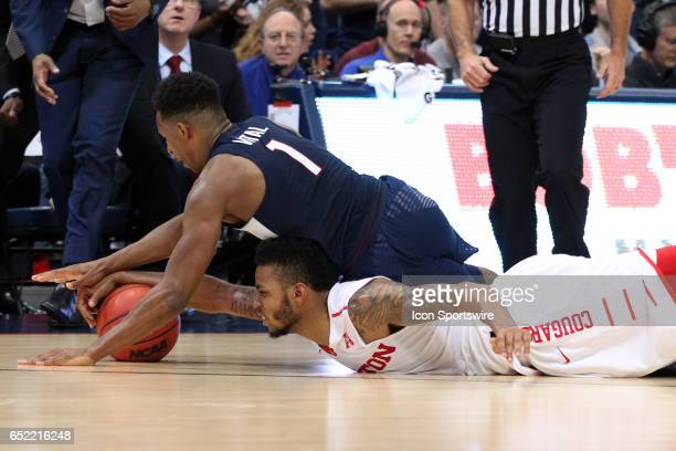 UConn Huskies guard Christian Vital and Houston Cougars forward Devin Davis battle for the loose ball during the second half of the American Athletic...