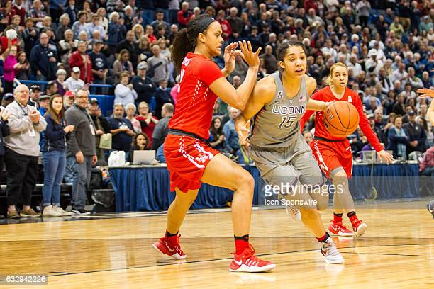 UConn Huskies Guard Gabby Williams works around Houston Cougar's Forward Brianne Coffman during the first half a women's NCAA division 1 basketball...