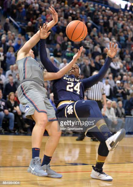 UConn Huskies Guard Kia Nurse and Notre Dame Fighting Irish Guard Arike Ogunbowale both fall after loosing control of the ball during the game as the...
