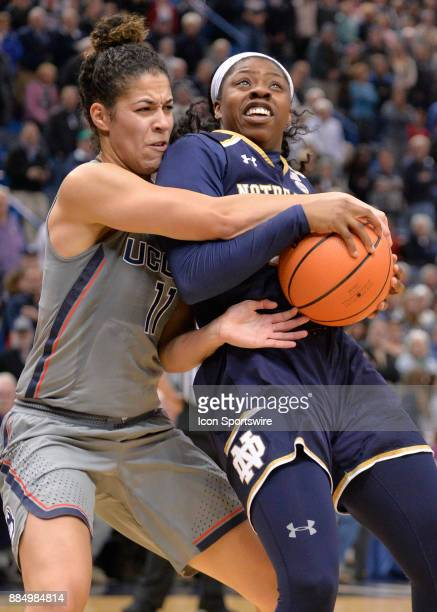 UConn Huskies Guard Kia Nurse fouls Notre Dame Fighting Irish Guard Arike Ogunbowale as she shoots during the game as the UConn Huskies host the...