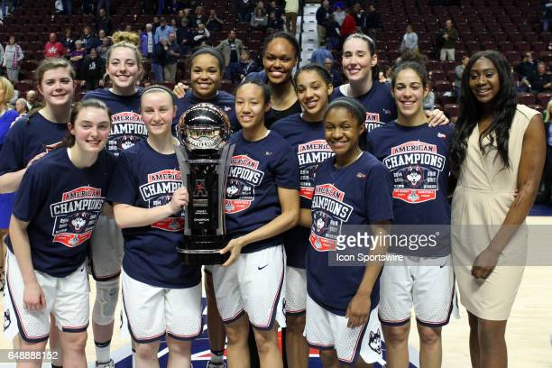 UConn Huskies players pose for pictures with the American Athletic Conference championship trophy on March 6 at Mohegan Sun Arena in Uncasville CT...