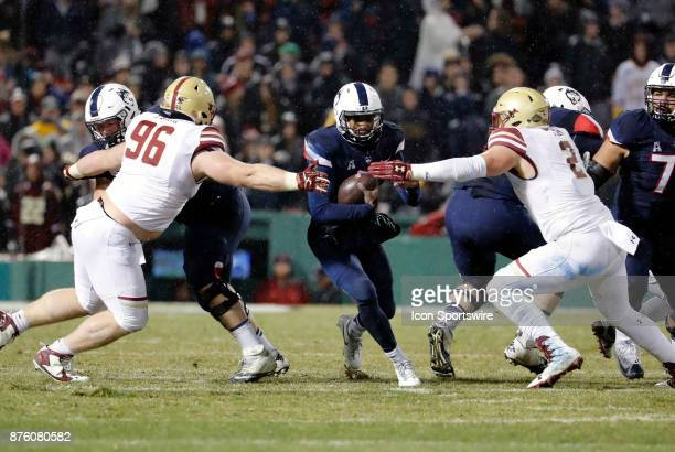 UConn Huskies quarterback David Pindell closed down byBoston College defensive tackle Ray Smith and Boston College defensive end Zach Allen during a...
