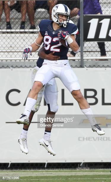 UConn wide receiver Mason Donaldson celebrates a touchdown catch against UCF on Saturday Nov 11 2017 at Spectrum Stadium in Orlando Fla