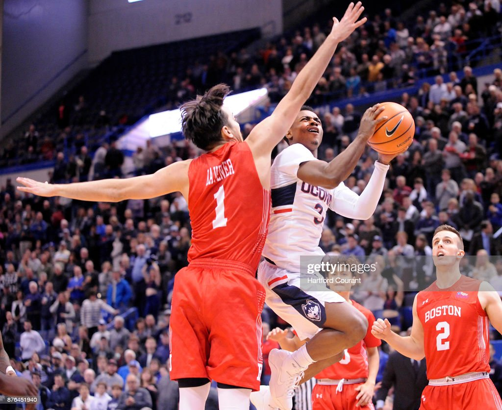 UConn's Alterique Gilbert drives to the hoop as Boston University's Nick Havener defends in the first half on Sunday, Nov. 19, 2017 at the at XL Center in Hartford, Conn. UConn won the game 85-66.