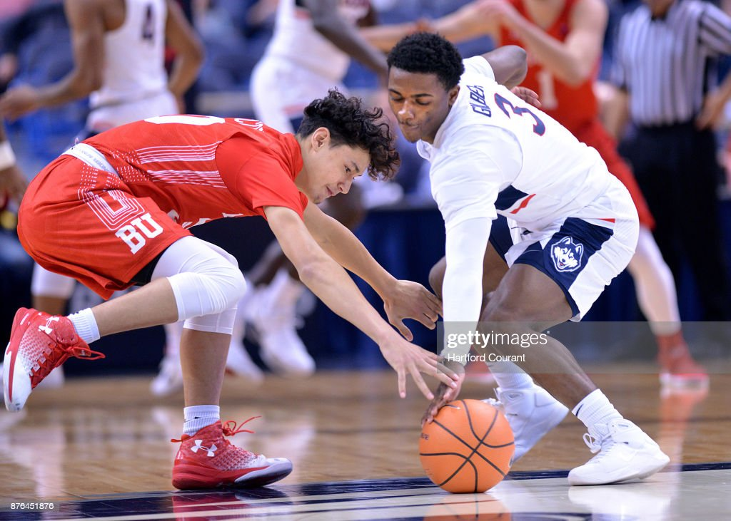 UConn's Alterique Gilbert, left, battles for a ball with Boston University's Javante McCoy in the first half on Sunday, Nov. 19, 2017 at the at XL Center in Hartford, Conn. UConn won the game 85-66.
