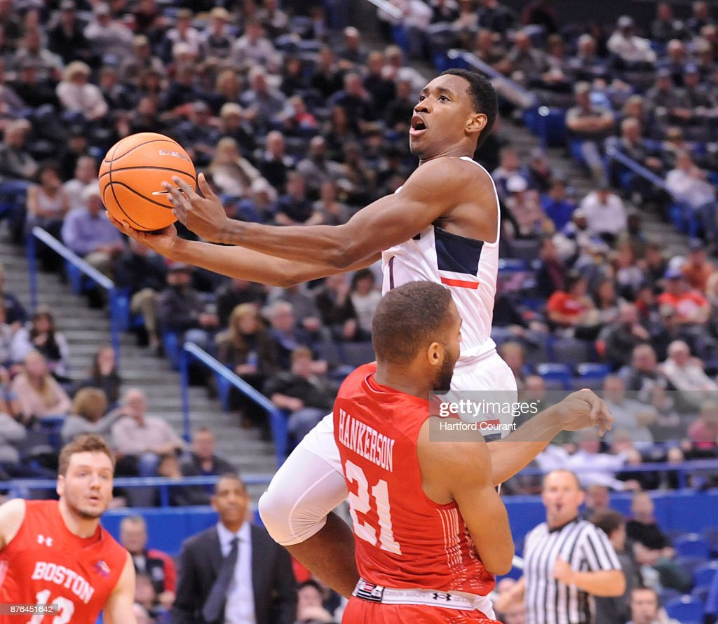 UConn's Christian Vital puts up a shot over Boston University's Cedric Hankerson in the second half on Sunday, Nov. 19, 2017 at the at XL Center in Hartford, Conn. UConn won the game 85-66.