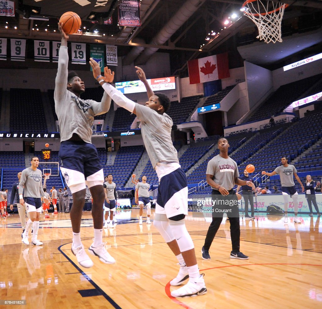 UConn's David Onorah puts up a shot as he works out with Josh Carlton before the game against Boston University on Sunday, Nov. 19, 2017 at the at XL Center in Hartford, Conn.