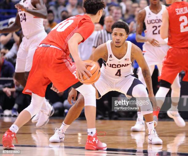 UConn's Jalen Adams defends as Boston University's Javante McCoy looks for room in the second half on Sunday Nov 19 2017 at the at XL Center in...