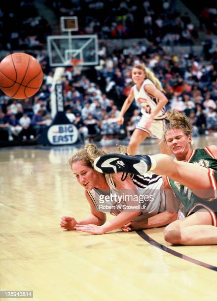 UConn's Megan Pattyson center dives for a loose ball during a game against the University of Miami Storrs CT 1991