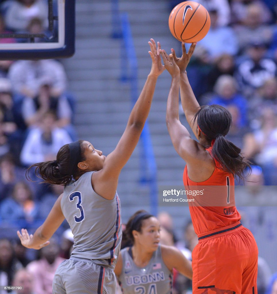 UConn's Megan Walker defends as Maryland's Ieshia Small puts up a jumper in the first half on Sunday, Nov. 19, 2017 at the at XL Center in Hartford, Conn. UConn won the game 97-72.