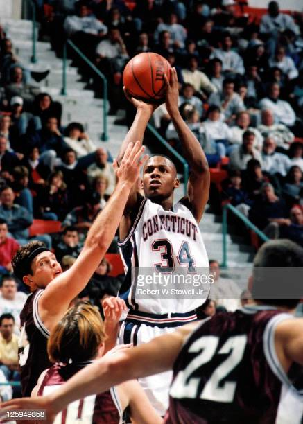 UConn's Ray Allen shoots over defense Hartford CT 1994