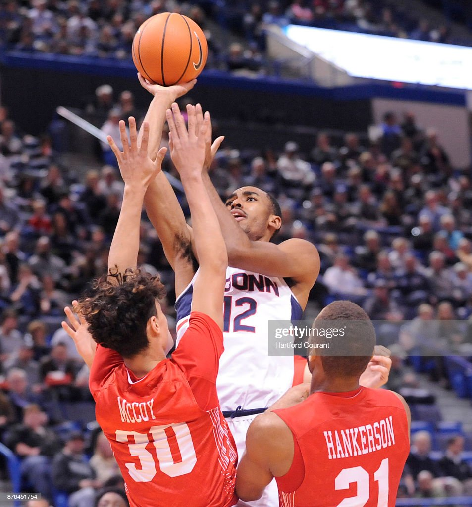 UConn's Tyler Polley puts up a shot over Boston University's Javante McCoy and Cedric Hankerson in the second half on Sunday, Nov. 19, 2017 at the at XL Center in Hartford, Conn. UConn won the game 85-66.
