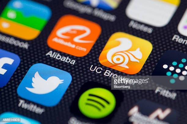 UCWeb Inc's UC Browser application icon top right is displayed next to an Alibaba Group Holding Ltd icon on an Apple Inc iPhone 5s in an arranged...