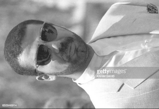 Uday Hussein the eldest son of Iraqi leader Saddam Hussein reflects earlier 12 December during a ceremony marking the resumption of Iraqi oil exports...