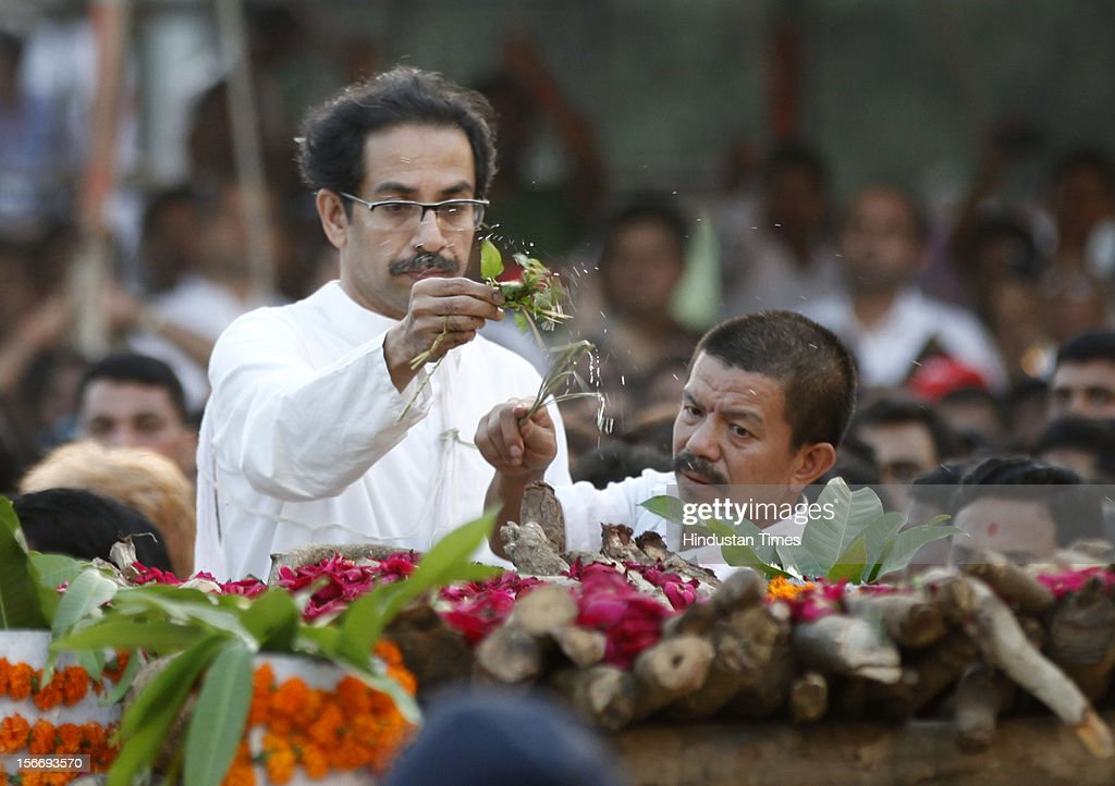 <a gi-track='captionPersonalityLinkClicked' href=/galleries/search?phrase=Uddhav+Thackeray&family=editorial&specificpeople=4252113 ng-click='$event.stopPropagation()'>Uddhav Thackeray</a> and Bal Thackeray's close aide Thapa perform the last rites during Sena chief's funeral at Shivaji Park on November 18, 2012 in Mumbai, India. Bal Thackeray passed away on November 17, 2012 at the age of 86 years.