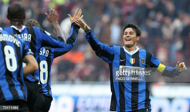 Inter Milan's defender Javier Zanetti is congratulated by his teammates Hernan Crespo and Patrick Vieira after scoring a goal against Ascoli during...