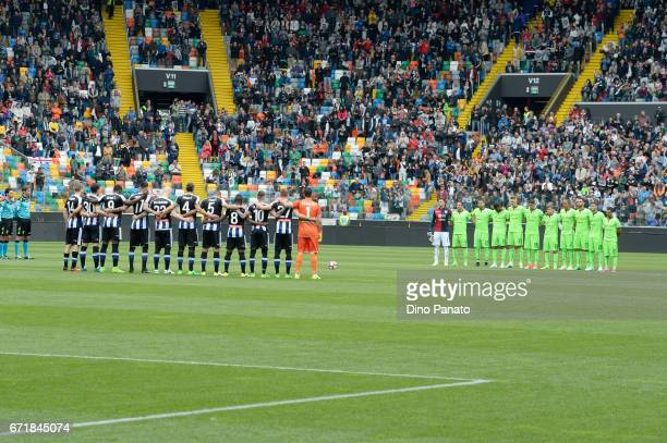 Udinese and Cagliari players observe a moment of silence in memory of Michele Scarponi during the Serie A match between Udinese Calcio and Cagliari...