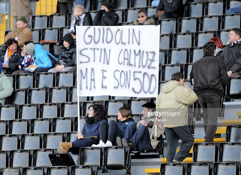 Udinese Calcio fans hold a banner as they show their support for coach Guidolin during the Serie A match between Udinese Calcio and AC Siena at Stadio Friuli on January 27, 2013 in Udine, Italy.
