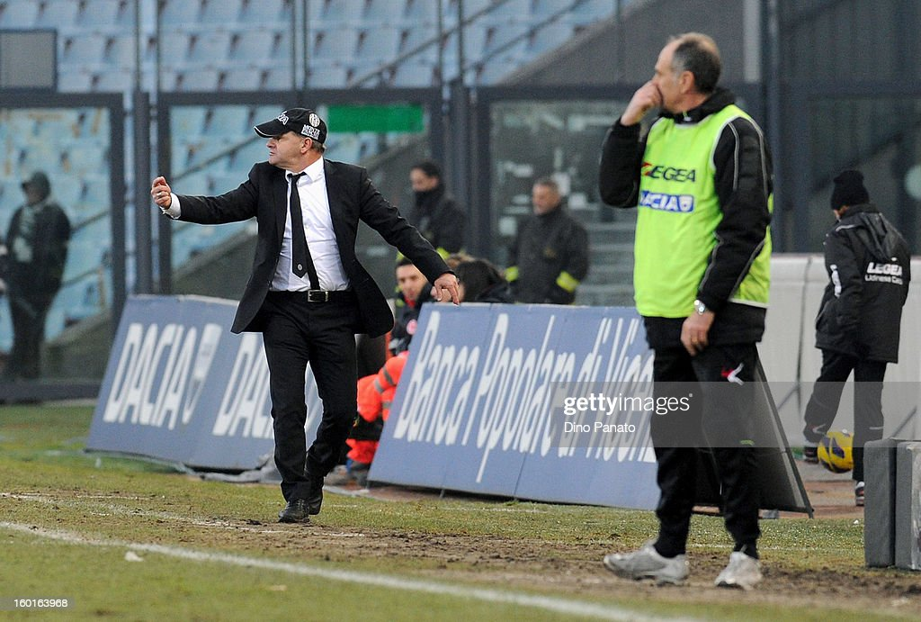 Udinese Calcio head coach <a gi-track='captionPersonalityLinkClicked' href=/galleries/search?phrase=Francesco+Guidolin&family=editorial&specificpeople=770478 ng-click='$event.stopPropagation()'>Francesco Guidolin</a> and AC Siena head coach Giuseppe Iachini watch from the touch-line during the Serie A match between Udinese Calcio and AC Siena at Stadio Friuli on January 27, 2013 in Udine, Italy.