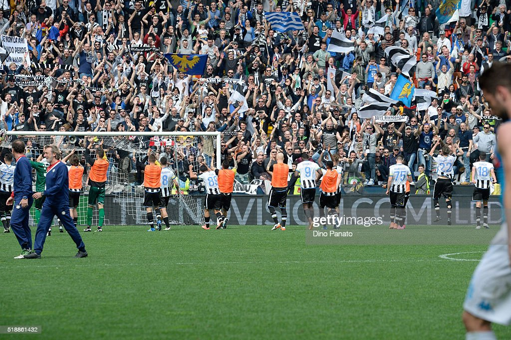 Udinese calcio players celebrate victory with fans after the Serie A match between Udinese Calcio and SSC Napoli at Stadio San Paolo on April 3, 2016 in Naples, Italy.