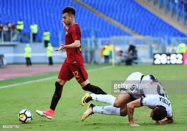 Udinese defender Giuseppe Pezzella falls next to AS Roma's forward Stephan El Shaarawy during the Italian Serie A football match AS Roma vs Udinese...