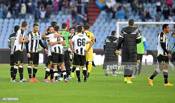 Udinese players celebrate victory after the Serie A match between Udinese Calcio and Atalanta BC at Stadio Friuli on October 26 2014 in Udine Italy