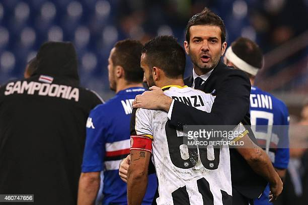 Udinese's coach Andrea Stramaccioni celebrates with Udinese's midfielder Giampiero Pinzi at the end of the Italian Serie A football match Sampdoria...
