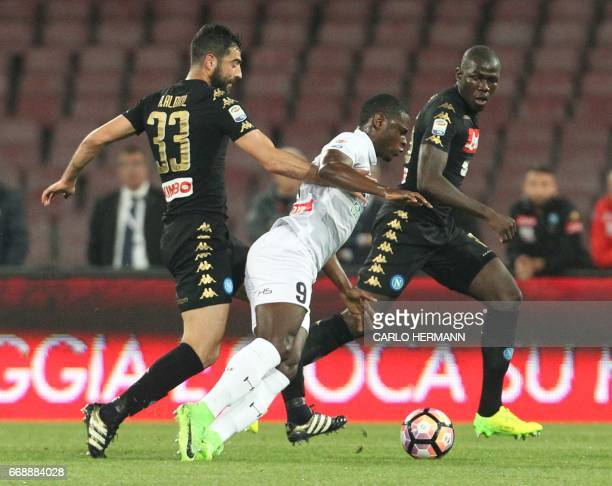 Udinese's Colombian forward Duvan Zapata fights for the ball with Napoli's Spanish defender Raul Albiol and Napoli's French defender Kalidou...
