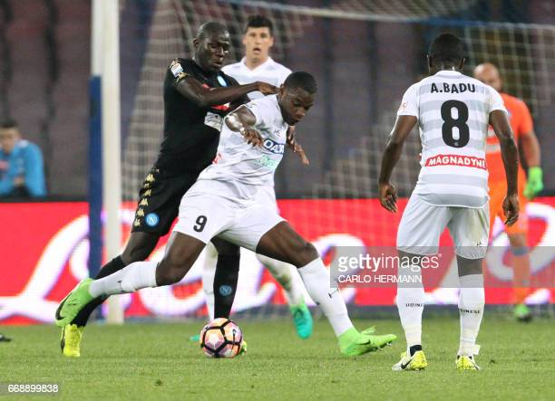 Udinese's Colombian forward Duvan Zapata fights for the ball with Napoli's French defender Kalidou Koulibaly during the Italian Serie A football...