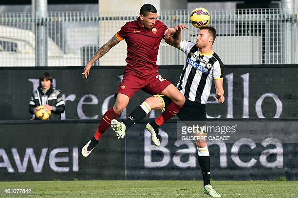 Udinese's defender from Switzerland Silvan Widmer fights for the ball with Roma's defender from Greece Jose Holebas during the Serie A football match...