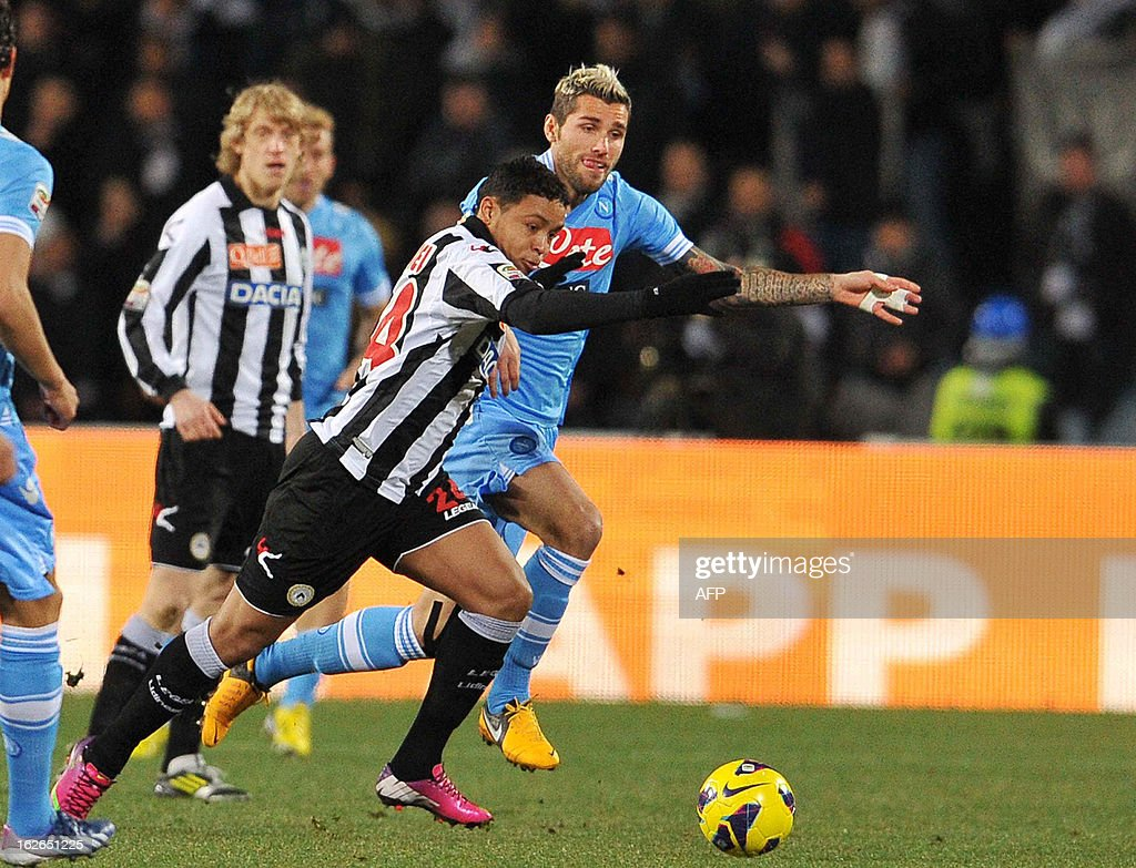 Udinese's defender of Colombia Muriel Fruto Luis Fernando (L) runs with the ball in front of Swiss Napoli's midfielder Valon Behrami (R) during their Serie A football match at Friuli Stadium in Udine on February 25, 2013.